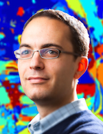 Portrait of Jason Corso, Assistant Professor of Computer Science and Engineering, inside his lab  Photographer: Douglas Levere
